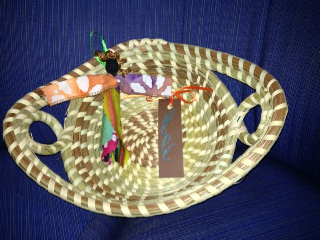 Low Country treasures - Small sweetgrass basket and a Gullah angel doll