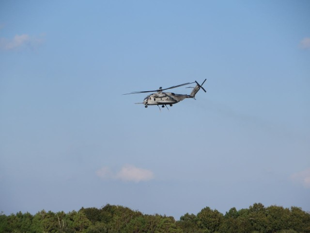 Helicopters take off, pass overhead, and land again over and over again