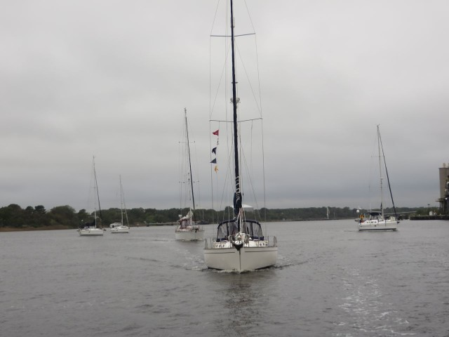 Sailboats heading for the opened bridge