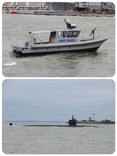 Police boat escorting the submarine into the shipyard (gray sub in gray water under gray skies. Do you see a theme here?