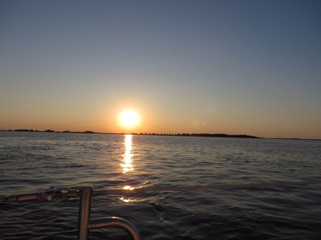 The sun was rising as we left Southport and headed out the Cape Fear Inlet