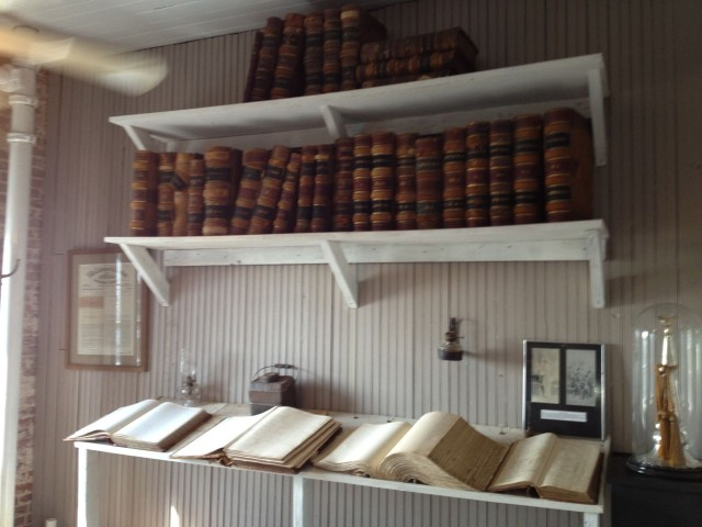 The shelves of old plantation and market ledgers