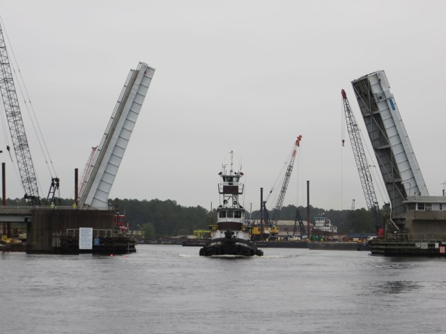 The tug comes through the bascule bridge first
