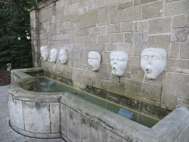 The fountain masks of Fuente de los Cantos