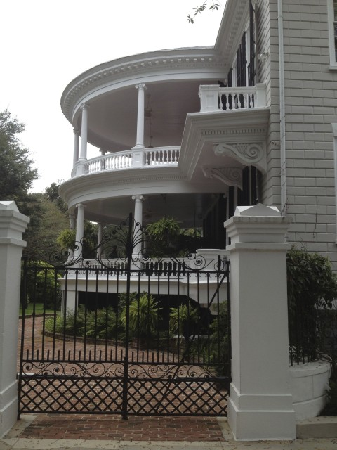 Gorgeous side portico and ironwork gate