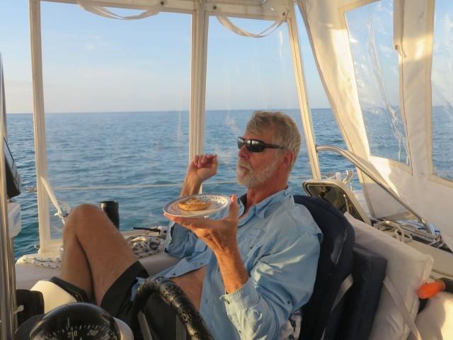 The Captain enjoys his bagel