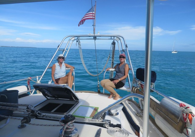 "Marcia and I held positions on the stern, our own version of ""rail meat.""  Our back seat driving comments actually did help on one or two occasions. Right, Skipper?"
