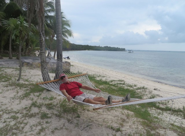 Al tests out the Grabbers' hammock on the beach at Fishers Bay.