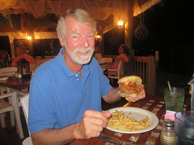 As Al is ready to enjoy a bite of his juicy bacon burger, he lets me know that he thinks  has run out of his cholesterol pills for the trip.