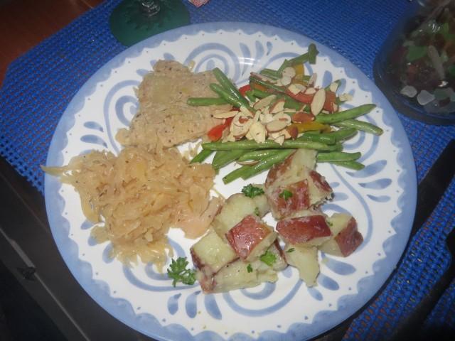 Pork, sauerkraut, green beans and red potatoes.