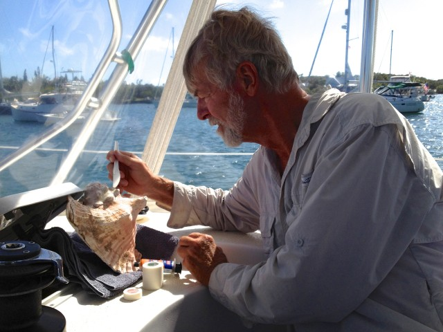 Al working on Peter's conch horn  with two-part epoxy.