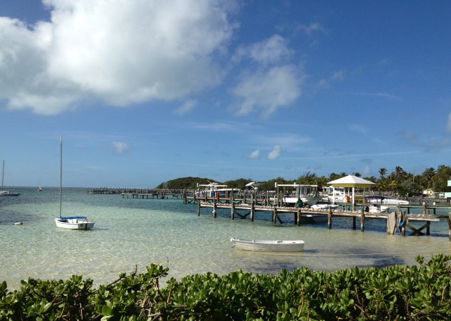Such a pretty sight, looking out to the harbor. This Guana Cay dock is lined with conch shells.
