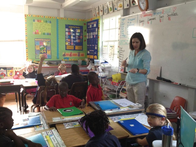 Miss Dee teaches 1st and 2nd graders in her classroom.