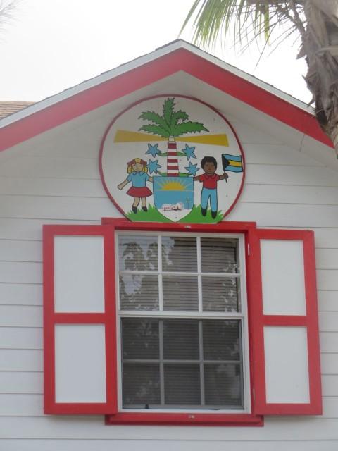 HT Primary School emblem