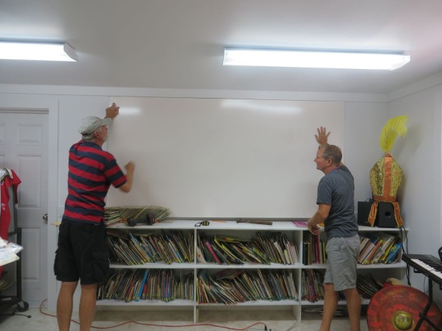 Al and Dan installing the whiteboard in the media center.