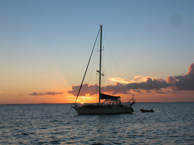 A cruiser anchored nearby took this photo of Kindred Spirit in the sunset and emailed it to us.