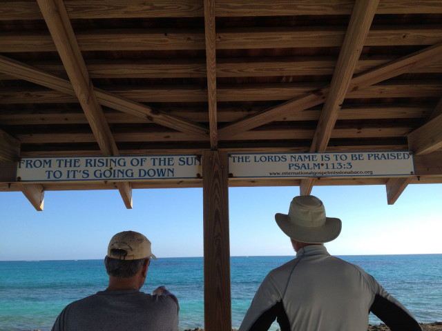 Gil and Al surveying the view from the pavilion. Notice the saying on the overhang.