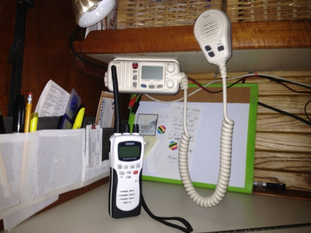 The main VHF radio attached to the navigation station (with an outside cockpit mic) and the handheld VHF radio.