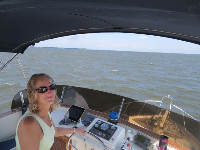 When we move up to the flybridge, I get to drive the boat. Windy day!