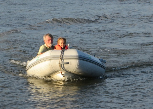 The boys go for a dinghy ride.