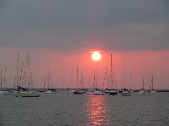 The sun set over the sailboats at Sandy Hook