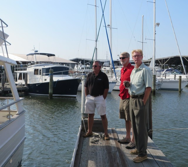 The men are waiting on the finger dock - John, the surveyor, Al and his brother Bill, our broker.
