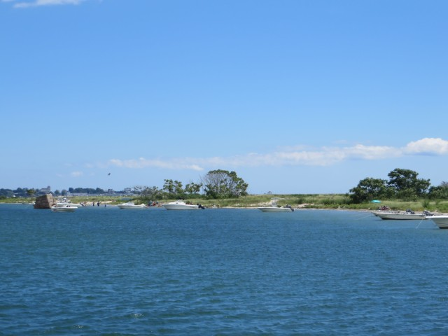 After rounding the point the channel passes the beaches where small boats anchor for a day trip.