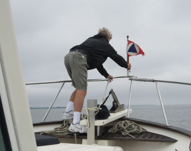 Heading for home - Al places our Shennecossett burgee on the bow.
