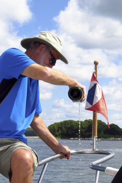 The Captain pours champagne over the bow while everyone toasts and salutes the new Kindred Spirit!