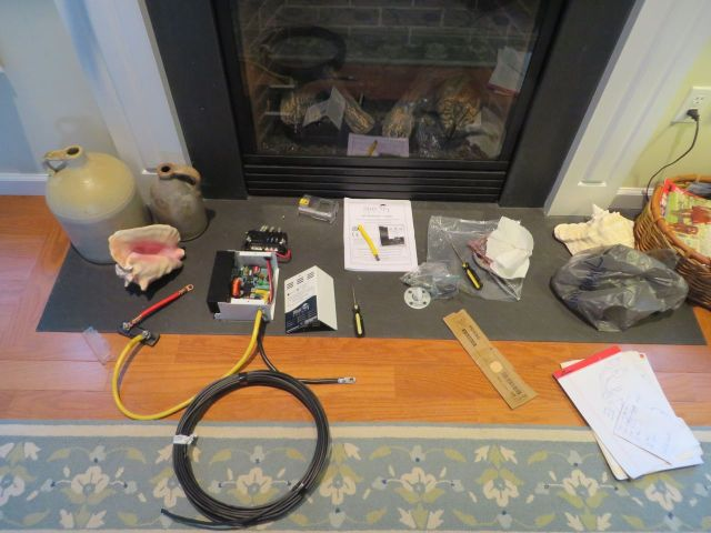 All the assorted wiring parts spread out in front of our fireplace