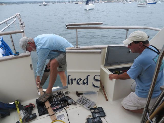 Al and Anthony work on reinforcing the transom.