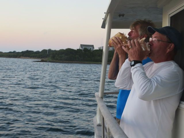 Al and Dean sound the conch horn at sunset. Yes, this is becoming quite a tradition.