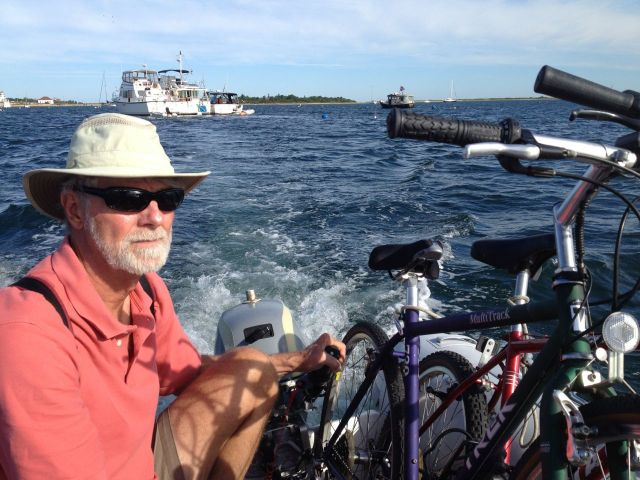 Getting the bikes to shore in the dinghy