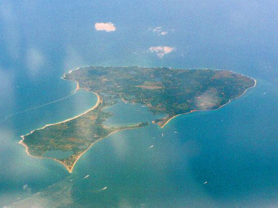 An aerial view of block Island, looking south. Salt Pond, or New Harbor, as it is also called, is the body of water near the center.