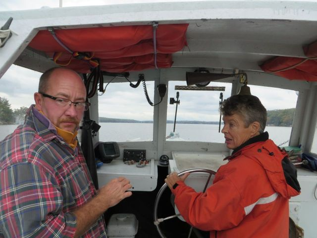 Laurie is at the helm while Peter prepares to haul traps up. Peter is the only one who can haul the traps since he has the license.