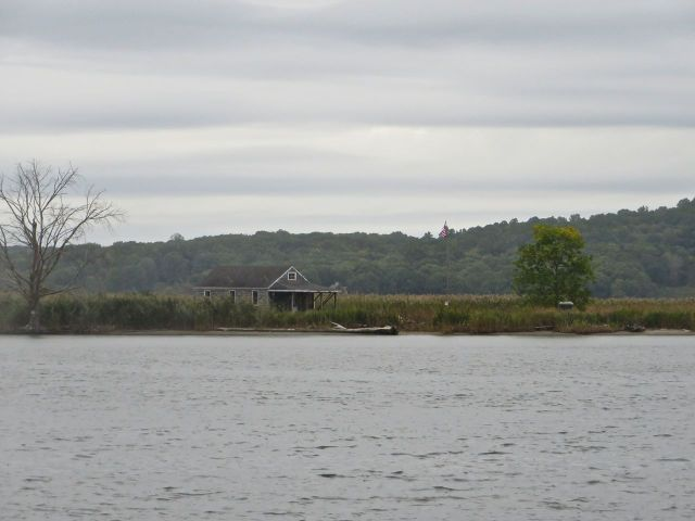 "We spotted this little house right on the water, in every sense of ""right on the water."" It's been there for years - good to see it it has not been swept away in any floods or storms."