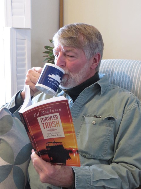 "Al's kind of reading - ""Trawler Trash, Confessions of a Boat Bum"". Notice his new coffee mug? It says ""I SIP DIESEL"""