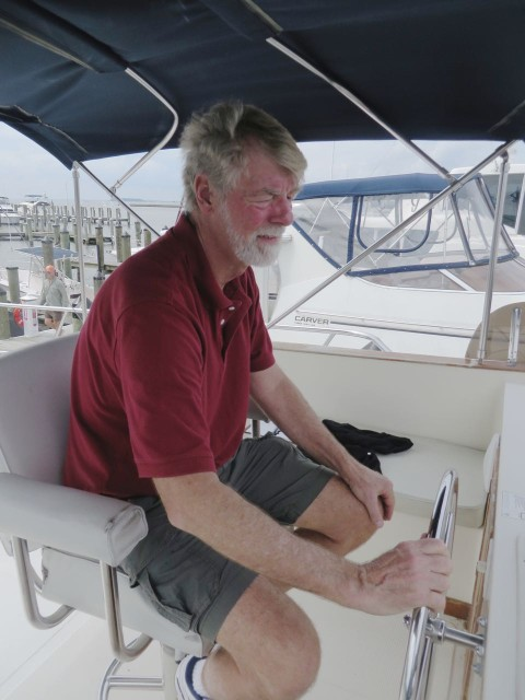 Al testing the steering during the survey, sitting on the single helm seat on the bridge.