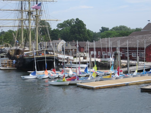 Isn't it interesting to see the modern sailing dinghies docked next to the old