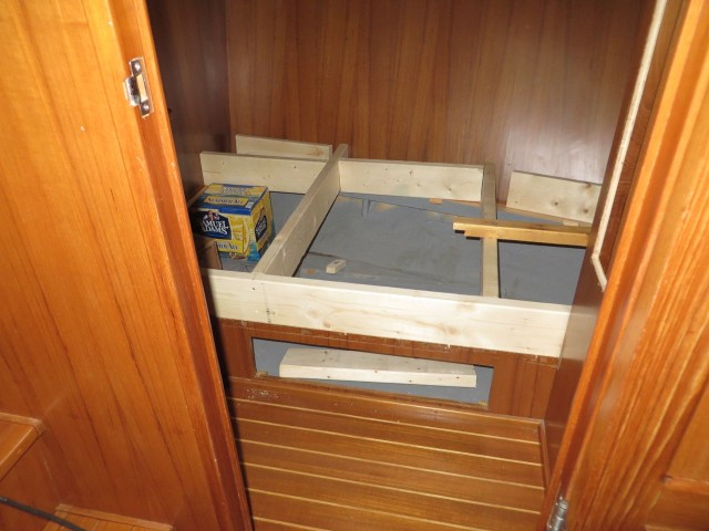 Framing to build up the bunk and provide more storage. The Sam Adams box was cut part and reassembled to match the size of potential batteries.