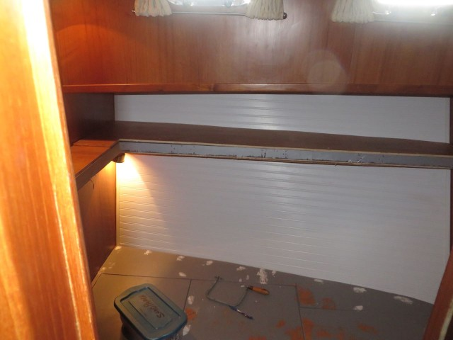 Another Grand Banks idea - brighten the cabin with white head board.