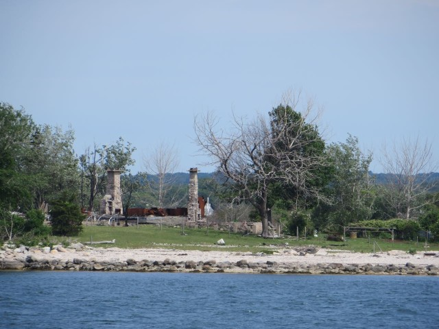 Chimneys remaining after the fires. We could see this as we passed by the island on earlier trips.