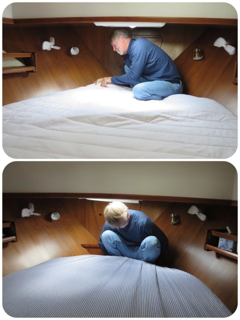 Adding on the mattress pad and making the bed. He does a fine job even if he is rather tall to fit there.