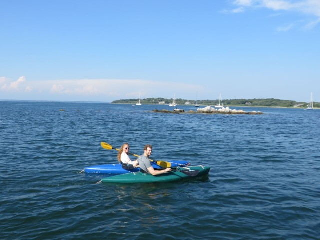 Mom and dad get to go kayaking around West Harbor.