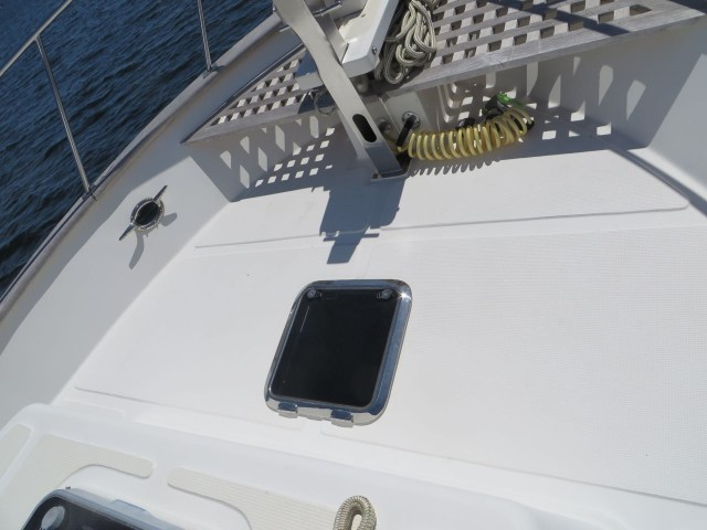 This is the new hatch on the bow, just behind the anchor windlass and teak grid.