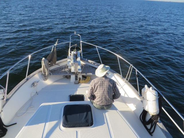 The captain takes a moment to enjoy a quiet time the bow.