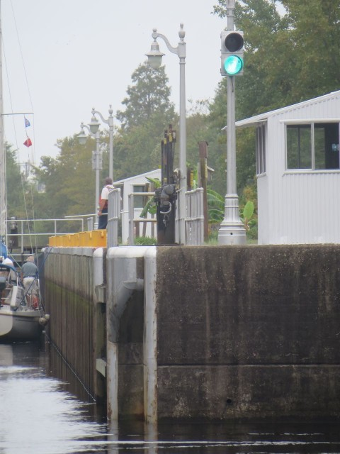 We have the green light so we enter the lock after the sailboat. Notice how low the water is.