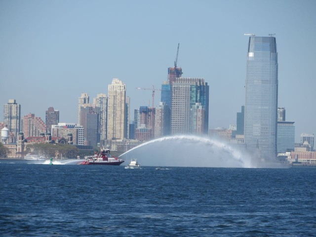 NYFD boat spraying a huge arc of water just past the Statue of Liberty. We were hoping it was a courtesy drive thru boat wash.