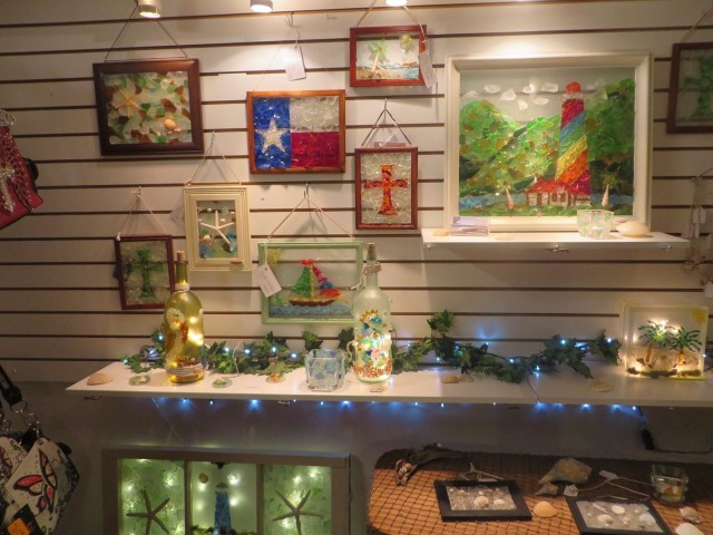 A display of sea glass art in al little shop.