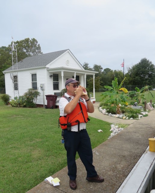 Robert has a LOT of conchs around the garden in front of his office. He took the time to demonstrate his conch horn blowing skill.